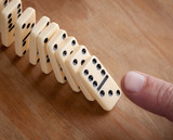 Finger pushing domino pieces