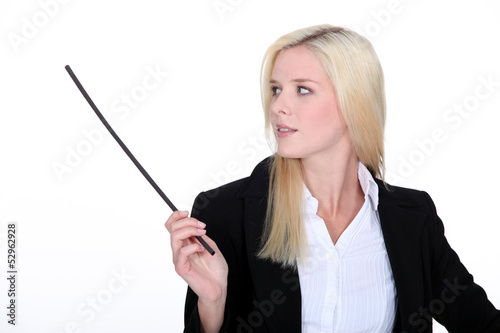 Woman in suit holding stick