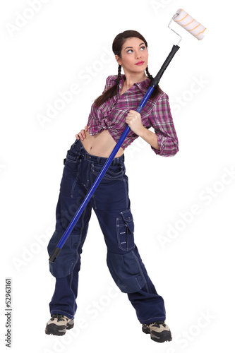 Sexy woman holding a paint roller
