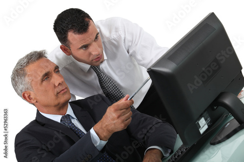 duo of businessmen with computer