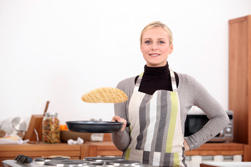 Woman making pancakes