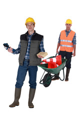 Two men with masonry equipment