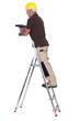 Senior carpenter stood up ladder with drill