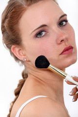 Woman putting make up on