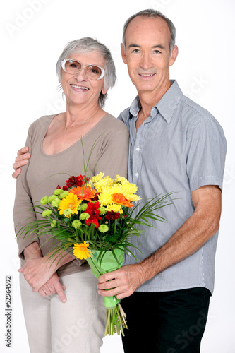 Husband giving wife flowers