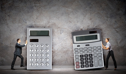 Businesspeople with big calculators