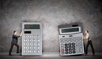 Businesspeople with big calculators