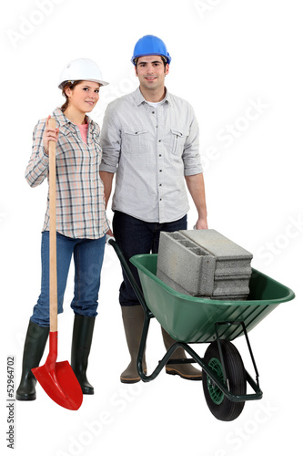 Young couple ready for construction works