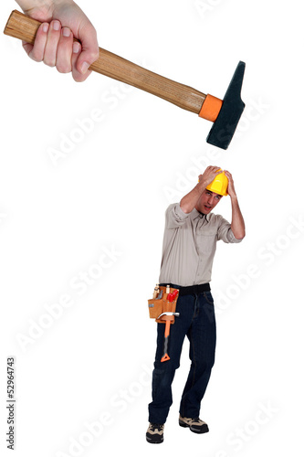 Construction worker being hit with a hammer