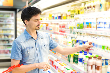 man in a supermarket buying milk shake