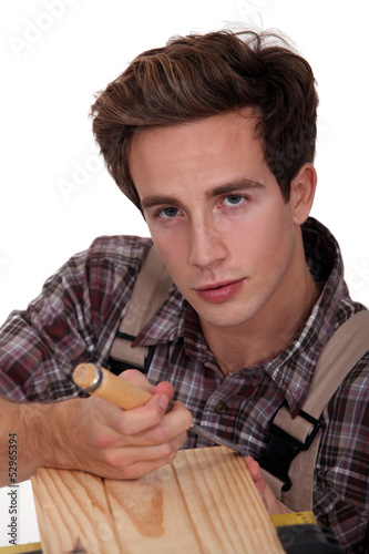 A carpenter using a chisel.