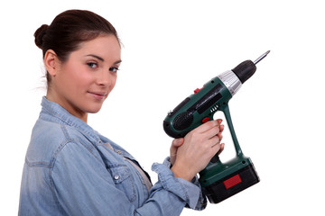 Woman holding drill on white background