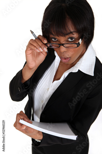 Businesswoman with notepad and pen