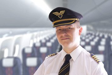 The pilot in the airplane cabin waiting for passengers