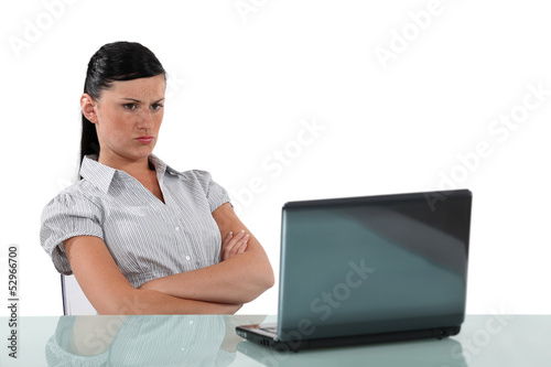 Angry woman sat in front of laptop