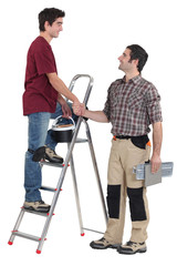 Two handymen shaking hands