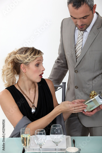 Surprised woman receiving a gift from her boyfriend