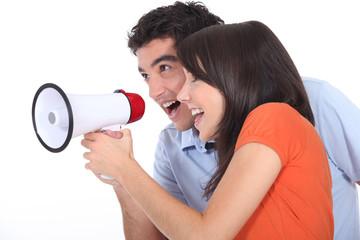 Teens with loudspeaker