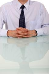 Man at desk awaiting interview