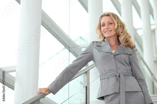 Businesswoman smiling on steps