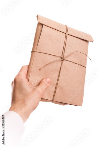 Male hand holds envelope tied with a rope isolated on white