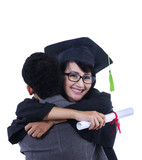 Boyfriend hug girlfriend on graduation - isolated