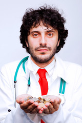 doctor holding coins in his hands