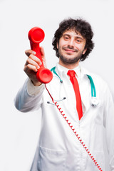 doctor showing a classic telephone reciver
