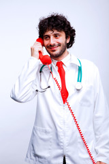 doctor speaking at telephone
