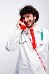 young doctor speaking at telephone
