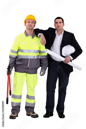 businessman and craftsman posing together