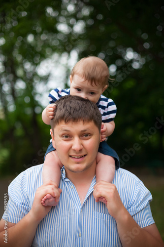 young father holding his young son