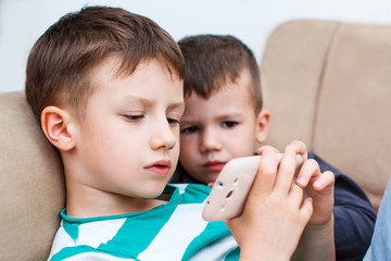 Boys playing on smartphone