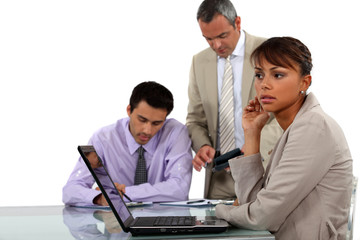 young businesswoman with laptop and male colleagues