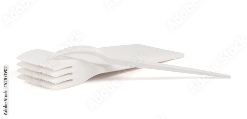 Disposable white plastic forks isolated