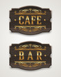 Vintage wooden signs for cafe and bar with golden lettering