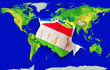 Fist in color  national flag of tajikistan    punching world map
