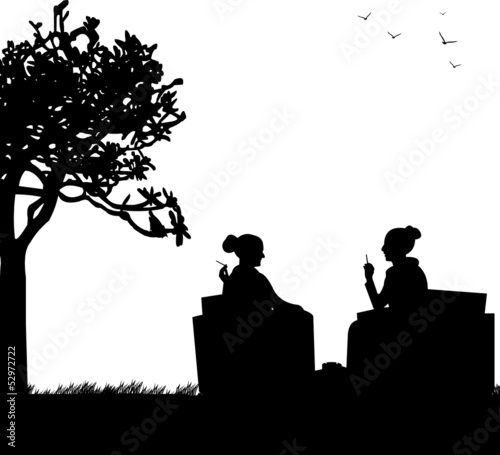Silhouettes of girls in garden smoking cigarettes
