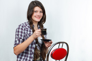 girl in a chair drinking coffee