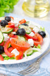 Greek salad with feta cheese, olives and vegetables, closeup