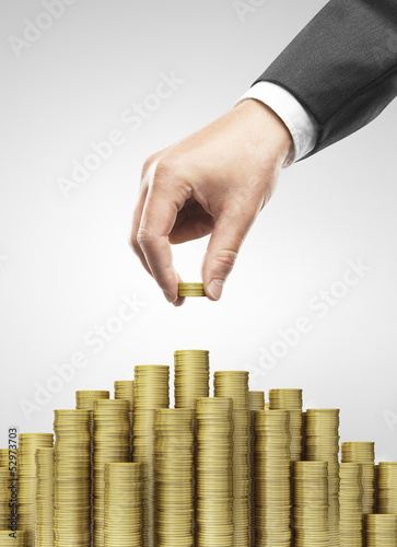 Hand put gold coins