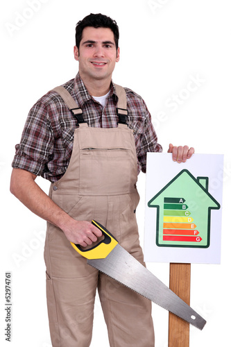 Builder holding up an energy efficiency rating sign