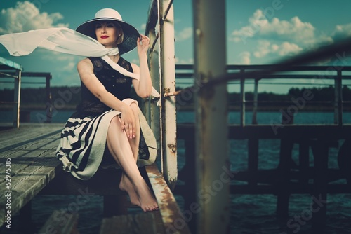 Beautiful woman wearing hat and white scarf