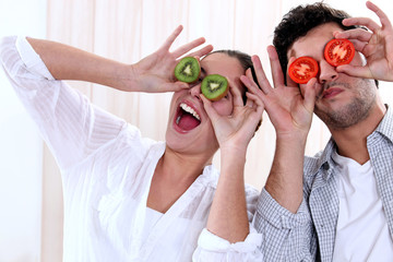 Couple messing around with fruit
