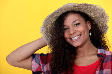 Brunette wearing straw hat