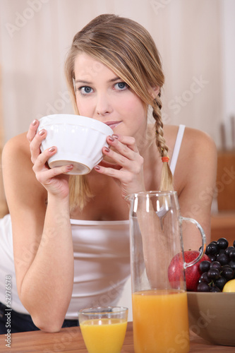 Blond woman having breakfast