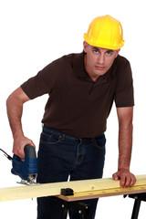 Craftsman making holes