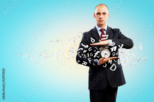 Business man holding alarmclock