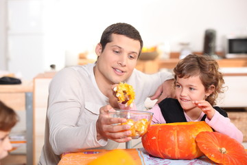 a father and his daughter at Halloween time