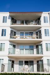 Four Condo Balconies Under Blue